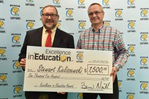 Stewart Kieliszewski (right) poses for a photo with Michigan Lottery public relations director, Jeff Holyfield, after accepting his Excellence in Education Award.
