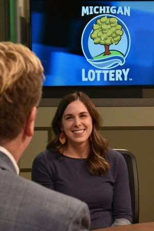 Tessa Bibler is interviewed after being presented with an Excellence in Education award from the Michigan Lottery.