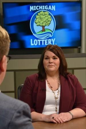 Katie Benavides is interviewed after being presented with an Excellence in Education award from the Michigan Lottery.