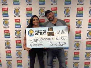 Josiph Stamevski and his fiancée, Aneessa, smile after collecting the $60,000 prize.