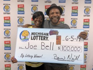 Joe Bell and Faye Bolton smile after Bell claimed a $100,000 Wild Bingo prize.