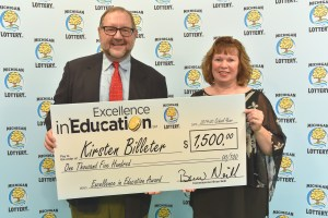 Kirsten Billeter (right) poses for a photo with Michigan Lottery public relations director, Jeff Holyfield, after accepting her Excellence in Education Award.