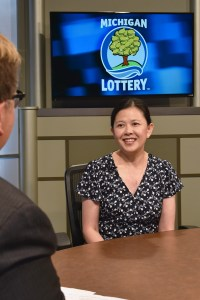 Lana Tran is interviewed after being presented with an Excellence in Education award from the Michigan Lottery.