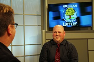 Nick Bierman is interviewed after being presented with an Excellence in Education award from the Michigan Lottery.