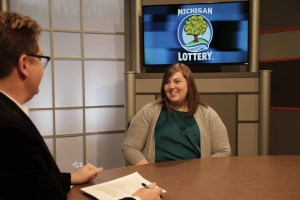 Haley Schulz Cucinello is interviewed after being presented with an Excellence in Education award from the Michigan Lottery.