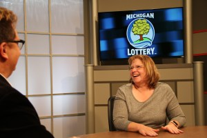 Kathryn Gonzales is interviewed after being presented with an Excellence in Education award from the Michigan Lottery.