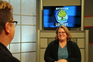 Cari Shephard is interviewed after being presented with an Excellence in Education award from the Michigan Lottery.