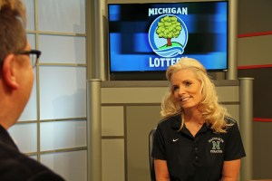 Colleen Anderson is interviewed after being presented with an Excellence in Education award from the Michigan Lottery.