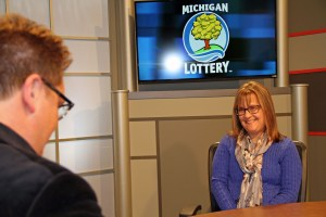 Karrie Marciniak is interviewed after being presented with an Excellence in Education award from the Michigan Lottery.