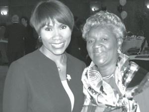 Portia Young, WISN Anchor, congratulates Senior Companion Barbara F. Thomas at program recognition luncheon.