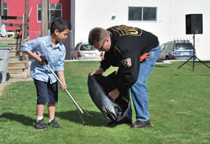 Cleanup- La Causa student and UPS volunteer