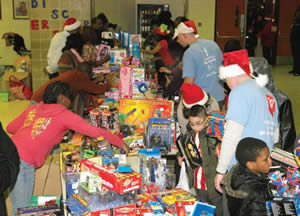 Hundreds of children received gifts and toys during the CYD event held on Friday, Dec. 27, 2013 at the North Division High School Campus. (Photo by Cy White)