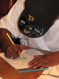 A young man works on a project during an Art Therapy class at SDC