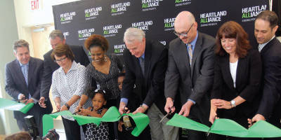 Tom Barrett and a few dignitaries cut the grand opening ribbon for the Maskani Place