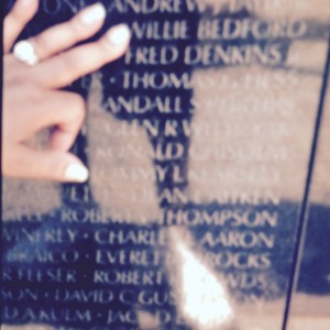 Loretta Scott touching Willie Bedford's name on the Vietnam Veterans Memorial Wall. Photo provided by Loretta Scott.