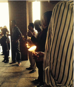 UWM students show solidarity with Charleston during a Monday vigil.