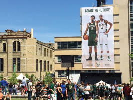 Visitors can see the Bucks' new jerseys on a banner draped across one Schlitz park building.