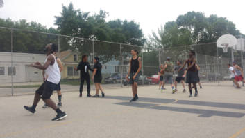 Milwaukee bands Rio Turbo and New Age Narcissism (NAN) play against each other in one game of basketball.