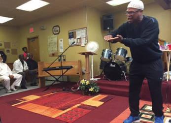 Spoken word artist Muhibb Dyer giving an impromptu performance at a memorial service for Taki S. Raton.