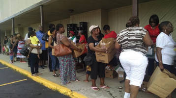 Visitors to the mobile pantry filled boxes of fresh produce, meat, dairy, and bread. They did not have to bring an ID to the pantry, which Greater New Birth Church organizes annually
