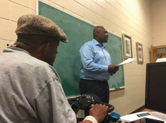 Dextra Hadnot gives a powerpoint presentation during an Aug. 12 seminar meant to help seniors make the most of their devices.
