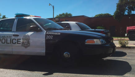 Cruisers sit parked outside of the District 7 police station. (Photo by Ariele Vaccaro.)