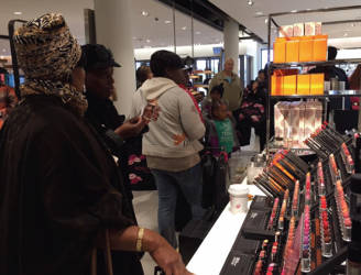 Shoppers browse the makeup selection during last week Friday's grand opening of Nordstrom. Photo by Ariele Vaccaro.