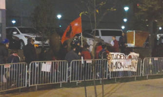 """Youth Empowered in the Struggle protested outside the Milwaukee Theater ahead of the first GOP debate Tuesday, shouting """"Dump Trump!"""" Photo by Ariele Vaccaro."""