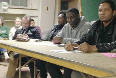 Jarrett English listens to members of the the Coalition of Justice at the Mass meeting. Photo by Dylan Deprey