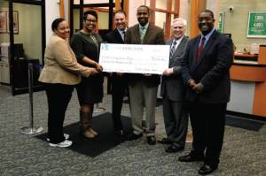 Alderwoman for the 6th District, Milele A. Coggs; Krystynn Taylor, branch manager for North Shore Bank; Michael Kellman, senior vice president, consumer lending at North Shore Bank; Deshea Agee, executive director for the King Drive BID; Darrel Eisenhardt, vice president of branch administration at North Shore Bank; Adrian Ruddock, loan offi cer for WWBIC. Photo by Melissa Warner.
