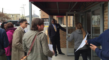 Dr. Means holds the door for protesters attending the Advisory Council meeting. Photo by Dylan Deprey