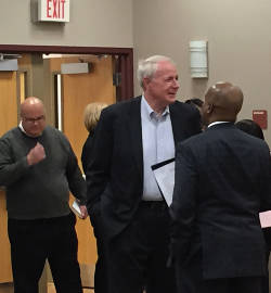 Mayor Tom Barrett and HUD Midwest Regional Administrator Antonio Riley speaking before the meeting. Photo by Dylan DePrey