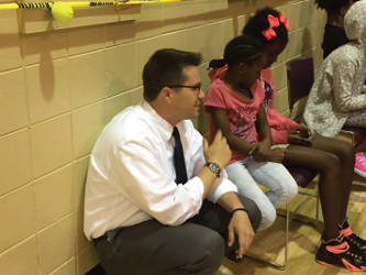 State Rep. Evan Goyke talks to young students at the Mary Ryan Boys and Girls Club about their texting habits. Photo by Dylan Deprey
