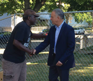 Andre Ellis welcomes Russ Feingold to speak the  accomplishment of We Got This. Photo by Dylan Deprey