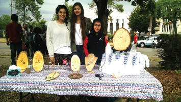 Amanda Contreras (left) displays her jewelry line for sale, accompanied by her daughter (middle) and step-son (right). (Photo by Mrinal Gokhale)