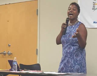 Sen. Lena Taylor speaking during at the Plymouth Church community debate. (Photo By Dylan Deprey)