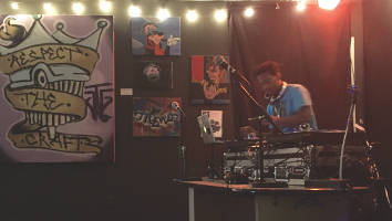 DJ The Jenius keeping the dance floor packed during his sets between local rappers' acts. (Photo By Dylan Deprey)