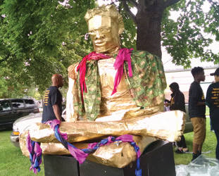 """Express Yourself Milwaukee displays their """"Golden Boy,"""" created by local youth from juvenile detention centers (Photo by Mrinal Gokhale)"""