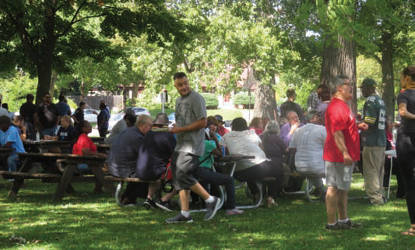 Members of the community gather in Sherman park for a barbeque hosted by Russ Feingold. (Photo by Karen Stokes)