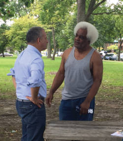 Russ Feingold discussing issues with community member Roger Griffin. (Photo by Karen Stokes)