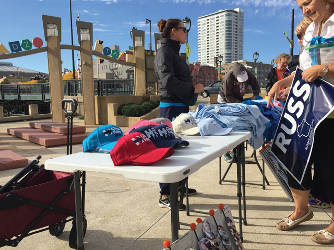 Supporters buying political merchandise outside the rally were directed towards the Zeidler Center for early voting. (photo by Dylan Deprey)