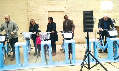 City officials dock the Bublr bikes newly installed at North Ave and Martin Luther King Jr Dr. (Photo by Mrinal Gokhale)