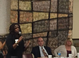 Iris Roley, along with panelists Kathy Harrell and Alfonse Gerhardstein, speak to elected officials and the community during the CC4QP Creating a Safer City: Community Dialogue Series Tuesday, Nov. 1. (photo by Dylan Deprey)