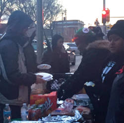 People lined up to indulge in the free hot meal. (Photo by Karen Stokes)