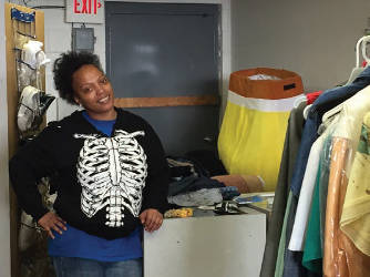 Shalonda Ezell works to help the children in her community one piece of clothing at a time. (Photo by Dylan Deprey)
