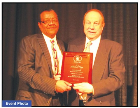 """Douglas Kelley, board president of the Center for Teaching Entrepreneurship, presenting an award to Atty. Michael F. Hupy at their annual """"Harvest of Hope Dinner""""."""