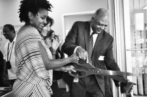 MPS College Access Coordinator Sharnissa Dunlap Parker (left), Great Lakes Higher Education Guaranty Corporation Chief Educational Opportunities Officer Amy Kerwin (center) and MPS Superintendent Gregory Thornton (right) cut the ribbon on MPS' new College Access Center – South.