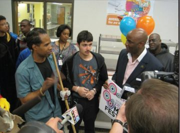 Sherman Dixon (left) accepts prize from McDonald's of Southeastern Wisconsin Co-op President Robert Pyles during surprise media event in May 2012.