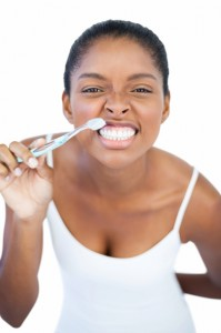 woman-with-toothbrush-smiling