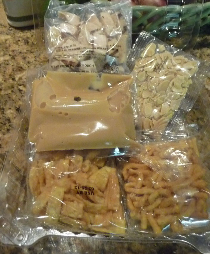 dressing, wontons, noodles, almonds and chicken